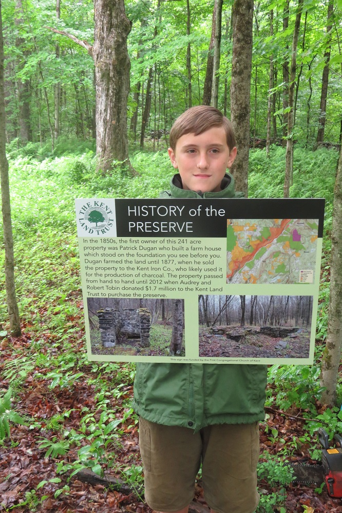 Tyler Fredritz with History sign comp