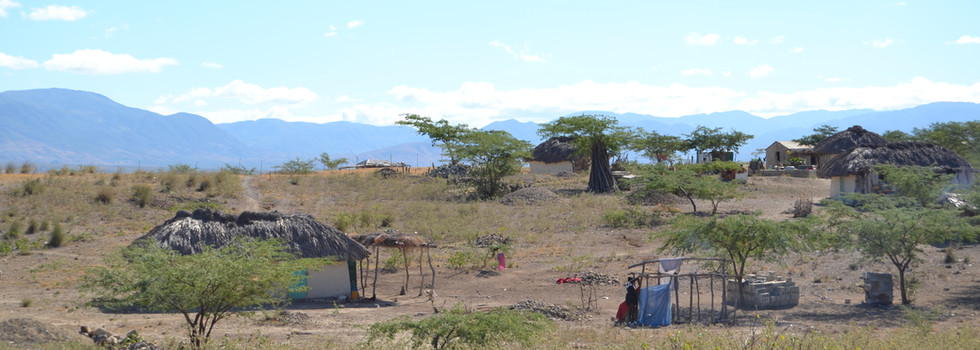 Some families now build more stable concrete homes instead of the usual mud and thatch.