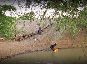 Boys getting water.JPG