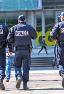 police officers in uniform walking