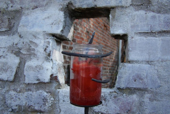a built wall with a candle fence