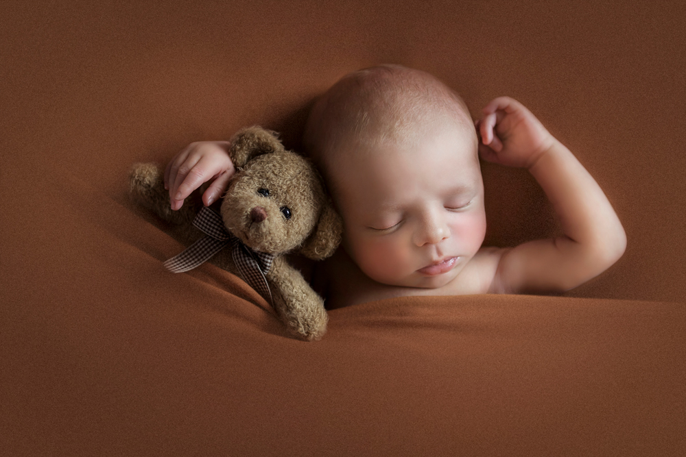 fine art newborn photography session man