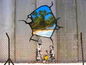 Banksy Art depicting a damage wall