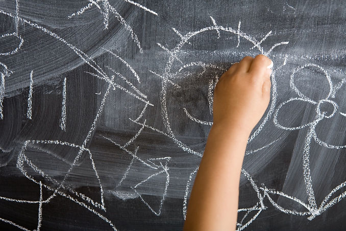 Child drawing on chalkboard at childminding child care setting The Wonder Years Bromley