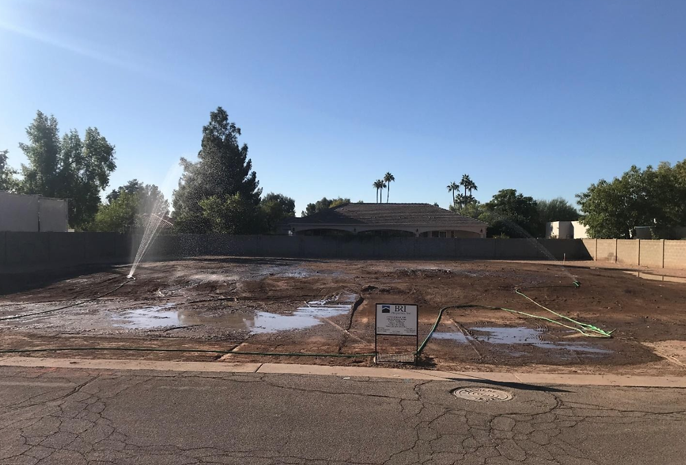 new construction lot being watered down