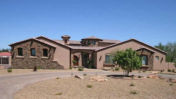 front of custom home with stone features