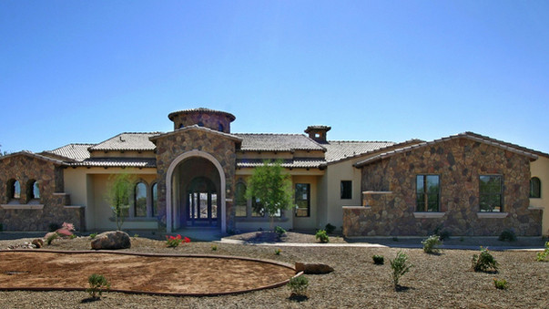 front of luxury custom home with desert landscaping