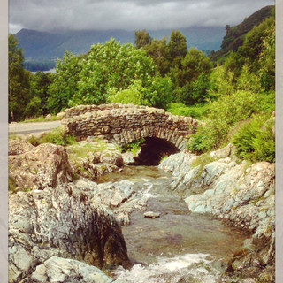 Ashness Bridge with clouds down on Skiddaw.