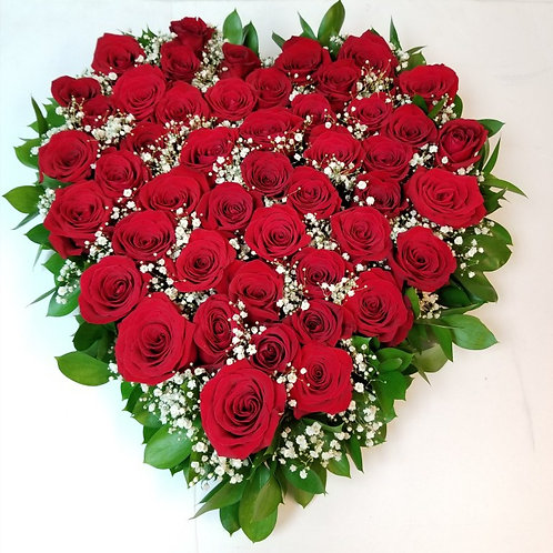 Heart of red roses arrangement