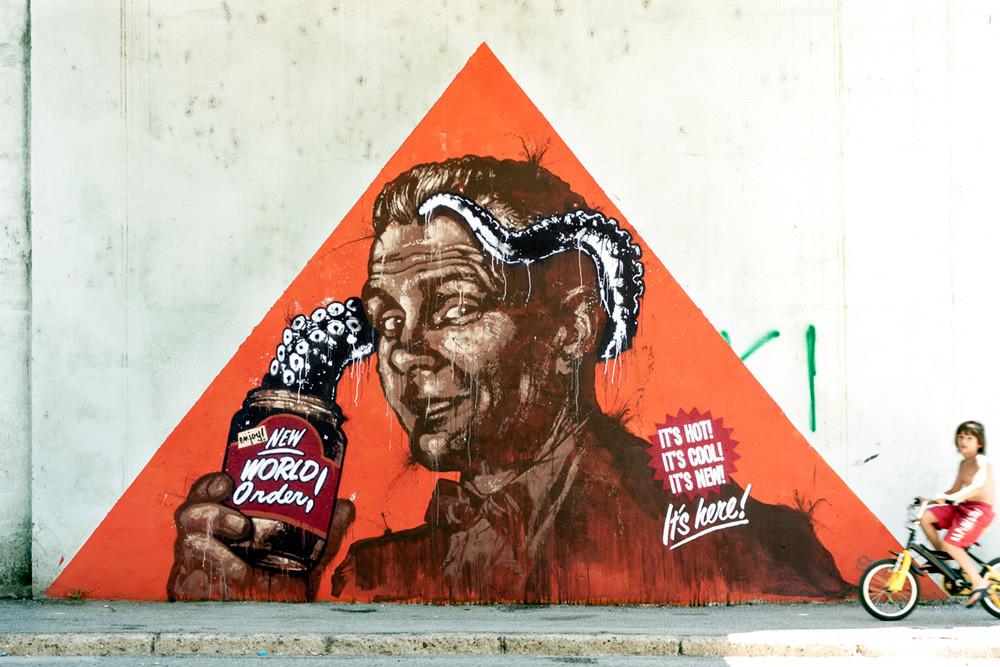 Spray paint and mixed media on wall