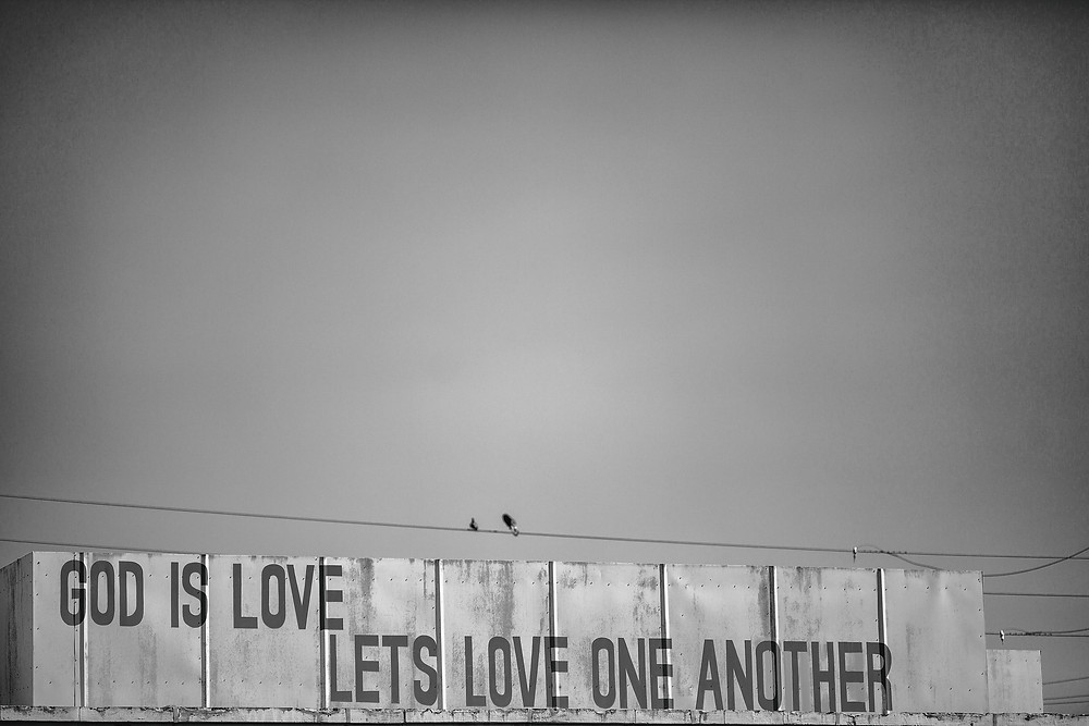"""""""God is Love Let Us Love One Another"""" by Thomas Hawk. No changes made.  https://creativecommons.org/licenses/by-nc/2.0/"""