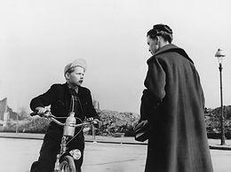 man-between-the-1953-002-child-in-bike-t