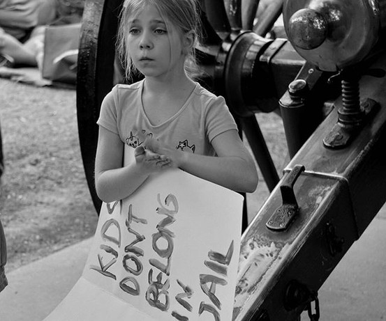 """Child participates in a """"Lights for Libe"""