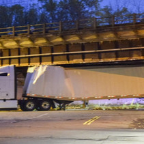 Semi Stuck Under Bridge.