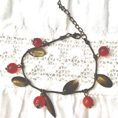 Red aget gem and brass setting adjustable bracelet