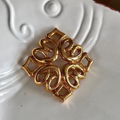 Retro gold tone brooch