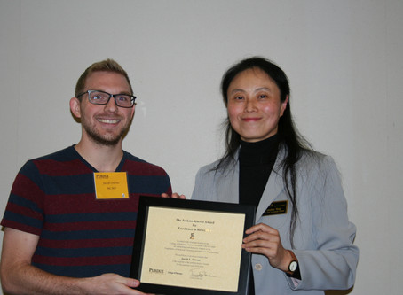 Jake win Jenkins-Knevel award at College of Pharmacy Research Symposium