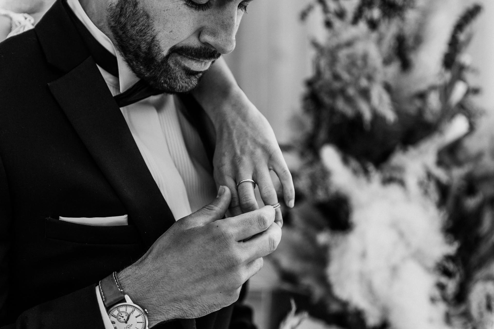 groom looking at ring.jpg