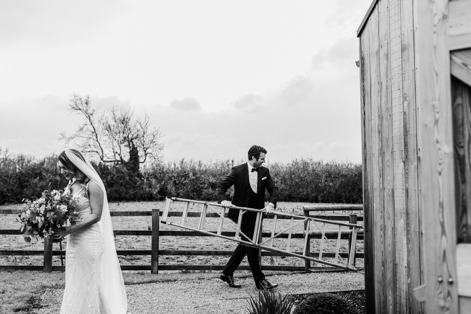 groom carrying ladder.jpg