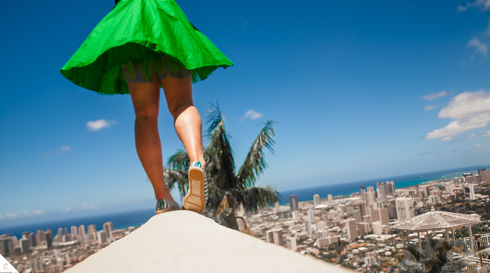 In a green dress, getting above the City to see the rooftops and Pacific Ocean.