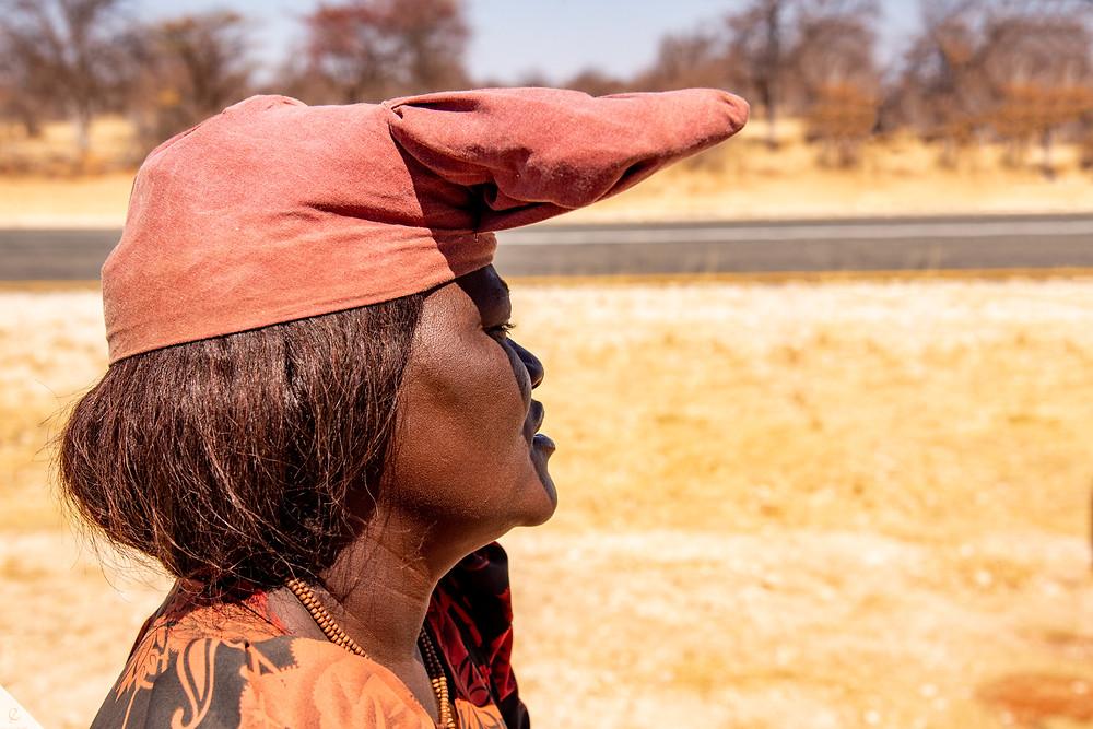 Herero woman with traditional horn-like headdress.