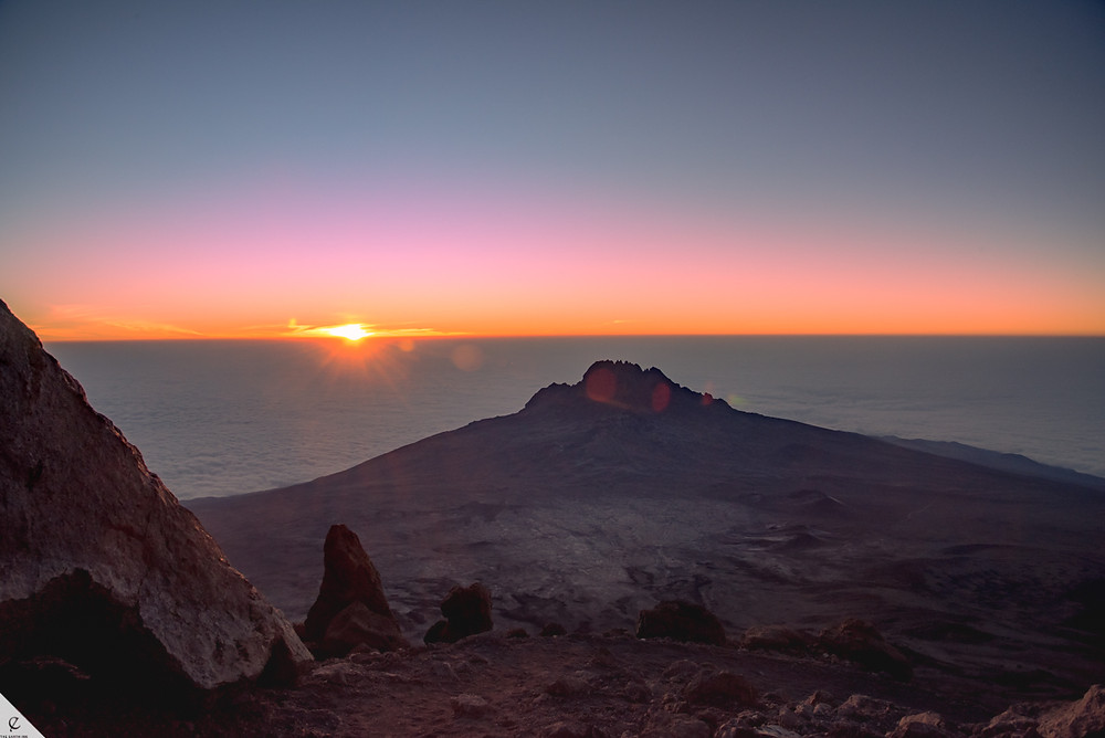 Watching sunrise from the slopes of Kibo on Kilimanjaro in Tanzania.