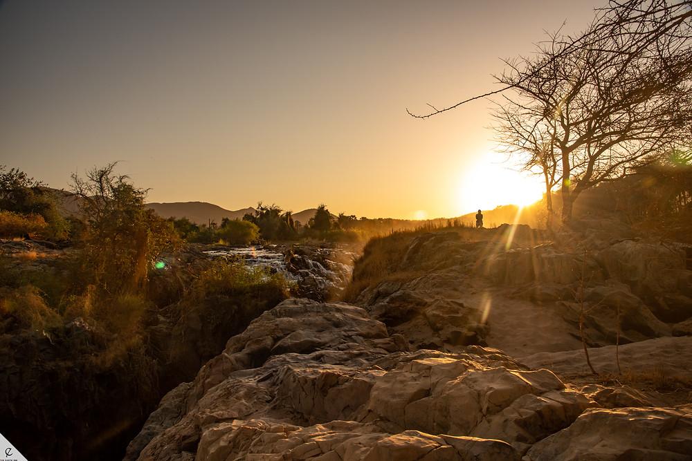 African sunrise over Epupa Falls on the Namibia-Angola border.