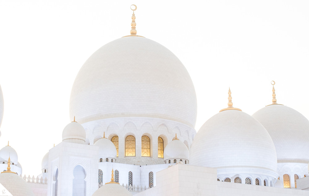 An inviting mosque of cultural learning and Islamic understanding, Sheikh Zayed Mosque in Abu Dhabi, United Arab Emirates is made of brilliant white domes, marble, chandeliers, and the world's largest Iranian carpet.