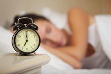 sleeping-woman-and-alarm-clock-bedroom-h
