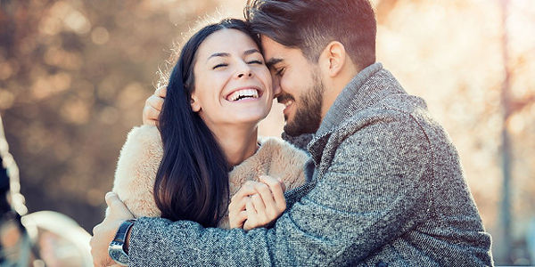web3-happy-young-couple-laugh-outside-st