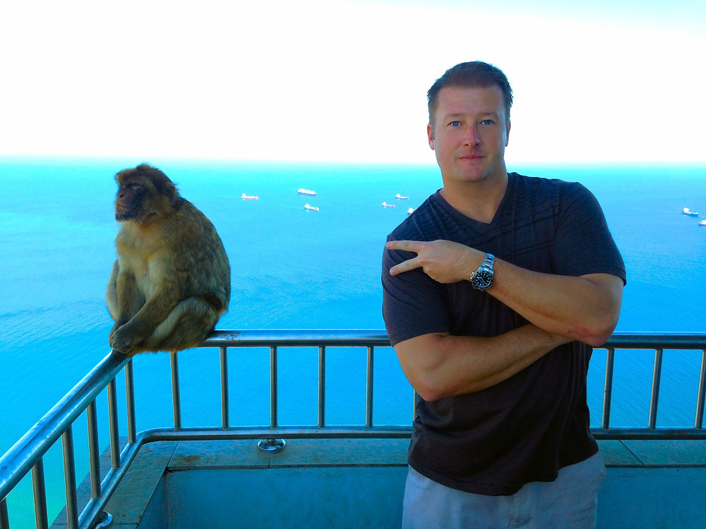 Posing with a monkey on the Rock of Gibraltar
