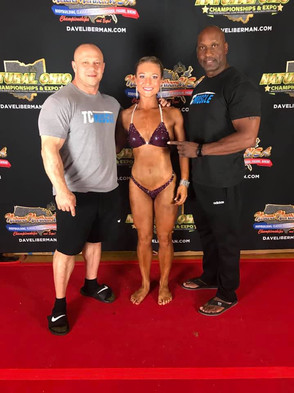 Congratulations to Sarah Miller on winning the overall women's physique division at the Natural Northern USA Bodybuilding Championships! All the long hours of training, cardio and dieting paid off.