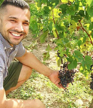 Look at that smile. Look at those grapes