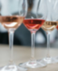 Row of glasses with white and rose wines