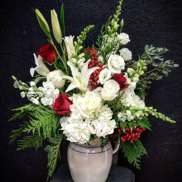 White and Green with a touch of Red Sympathy Arrangement