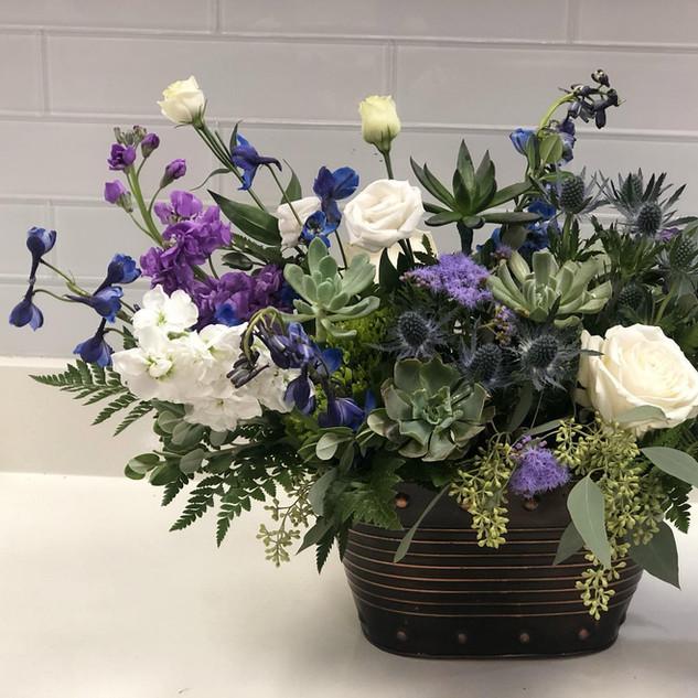 Low Sympathy arrangement featuring succulents