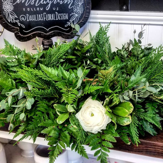 Mixed greenery cremation urn wreath