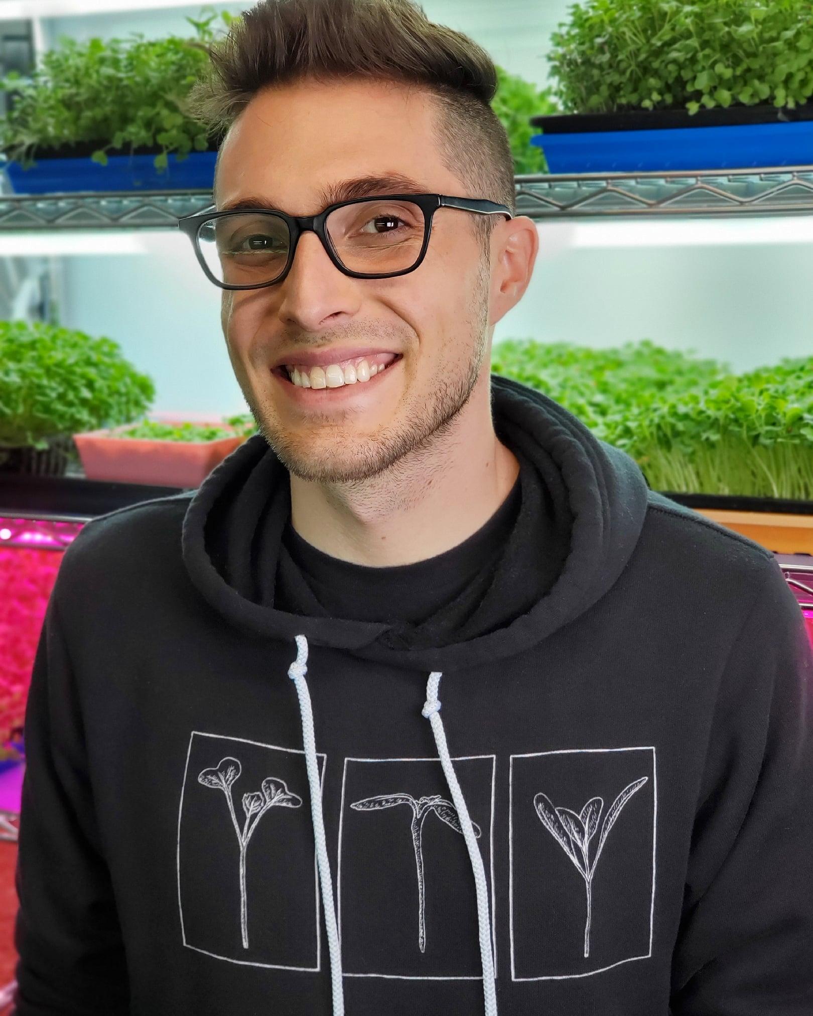 CJ Vaughn Owner of On The Grow, LLC wearing our Three Microgreens Shirt Design