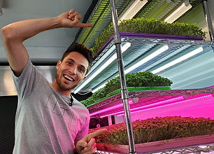 CJ Vaughn Owner of On The Grow, LLC showing Grow Lights for growing Microgreens Indoors