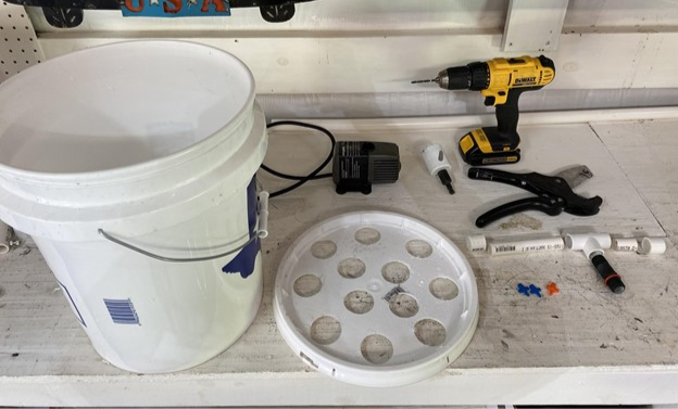 Areoponics bucket grow system with holes in lid and PVC connections - On The Grow
