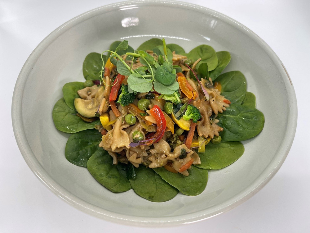 Microgreen Veggie Stir Fry by Debbie Warbington and On The Grow on bed of Spinach