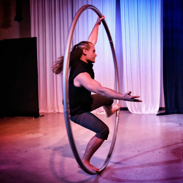 Jamie spins in a Cyr wheel