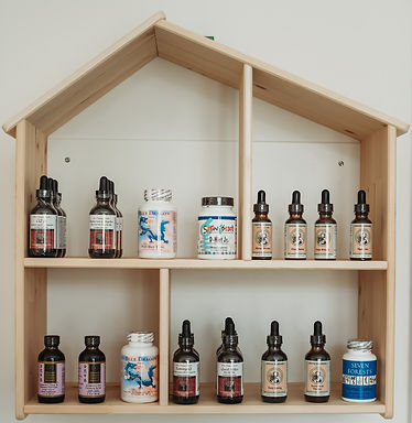 Chinese herbal tinctures for kids in wooden house