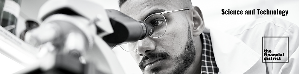 Science & technology: Scientist using a microscope in laboratory in the financial district.
