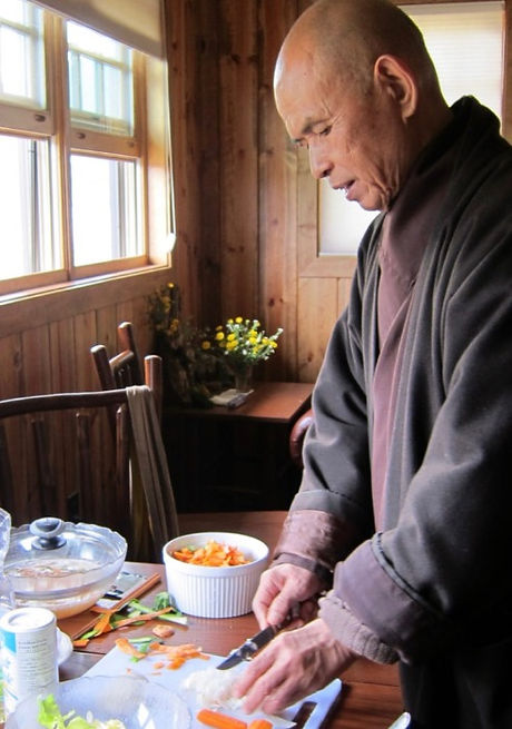 Thich-Nhat-Hanh-cooking-chopping-carrots-719x1024_edited.jpg