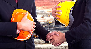 two workers are shaking hands