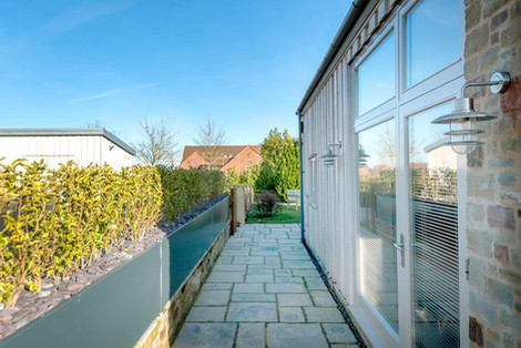 Stone Cottage patio doors onto garden