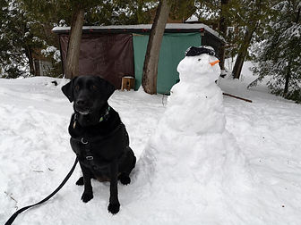 Bella with Snow man.jpeg