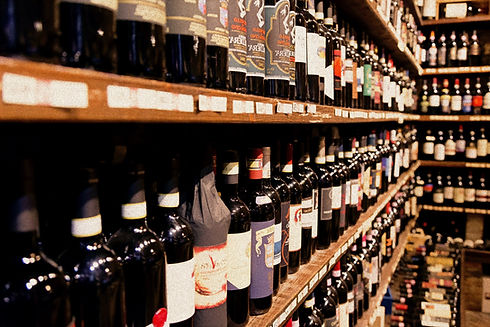 assorted wine bottle lot displaying on r