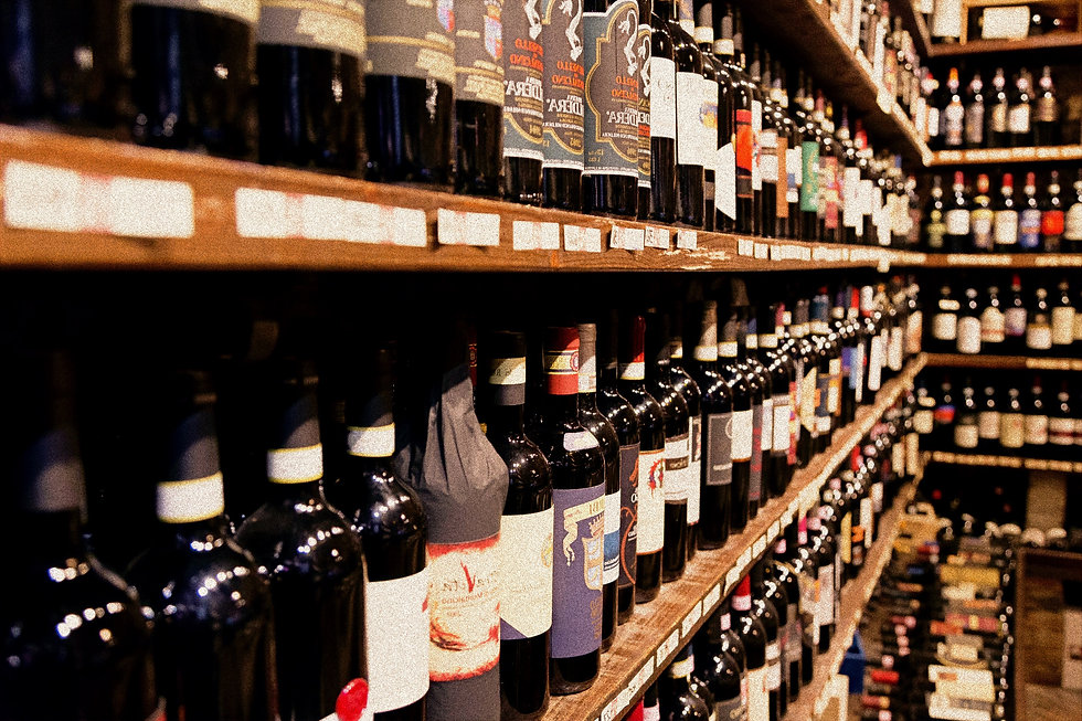 assorted wine bottle lot displaying on rack_edited.jpg